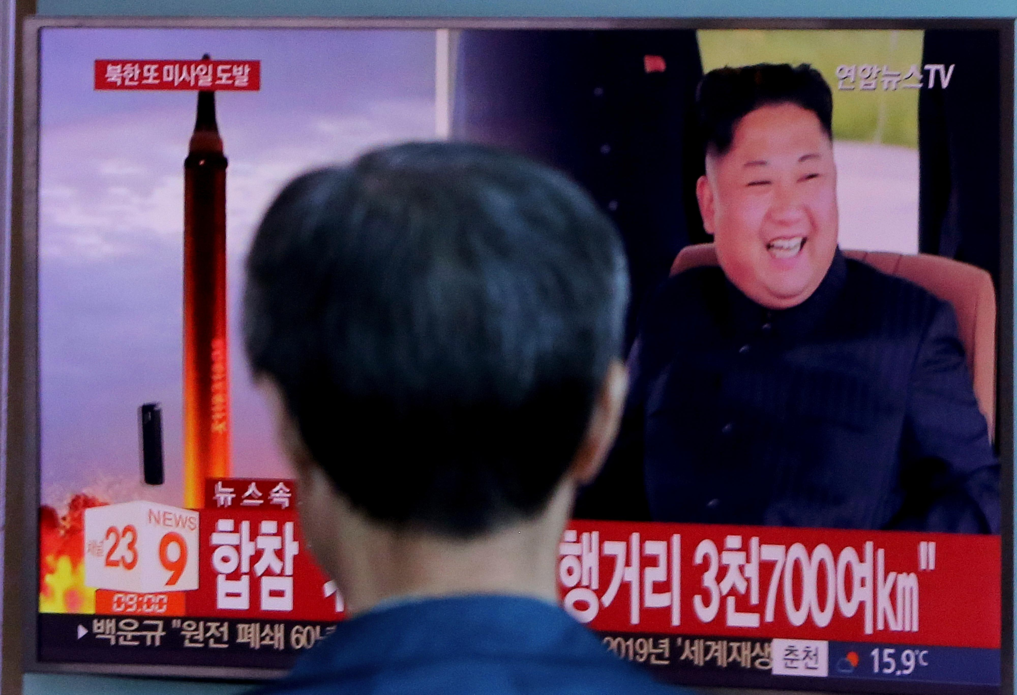 "A man watches a TV screen showing a file footage of North Korea's missile launch and North Korean leader Kim Jong Un, at the Seoul Railway Station in Seoul, South Korea, Friday, Sept. 15, 2017. South Korea's military said North Korea fired an unidentified missile Friday from its capital Pyongyang that flew over Japan before landing in the northern Pacific Ocean. The signs read ""South Korea's Joint Chiefs of Staff said the missile traveled about 3,700 kilometers."" (AP Photo/Ahn Young-joon)"