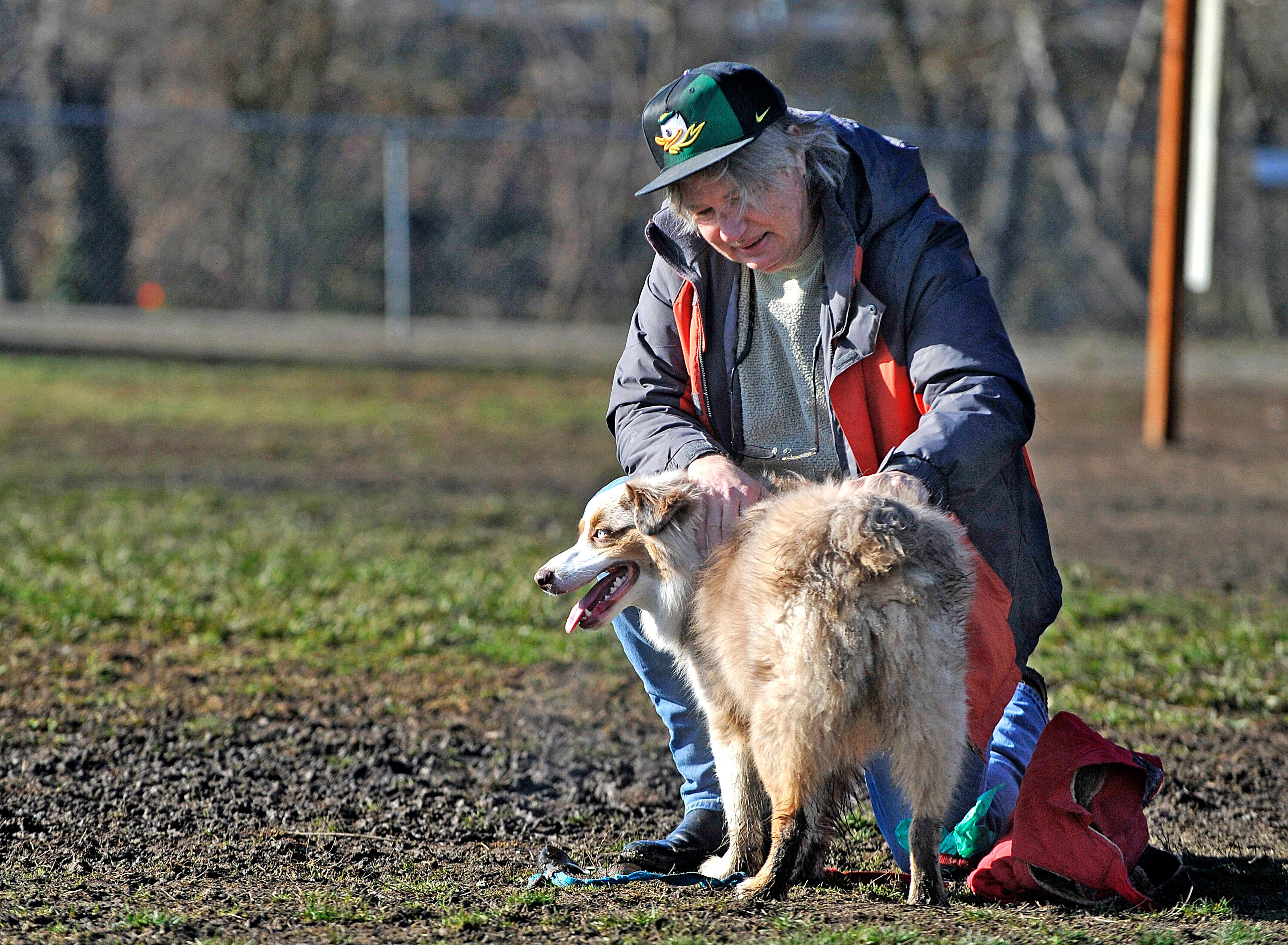 Tyler Henry shares a moment with dog Zoey at the Bear Creek dog park in Medford on Wednesday. Jamie Lusch / Mail Tribune