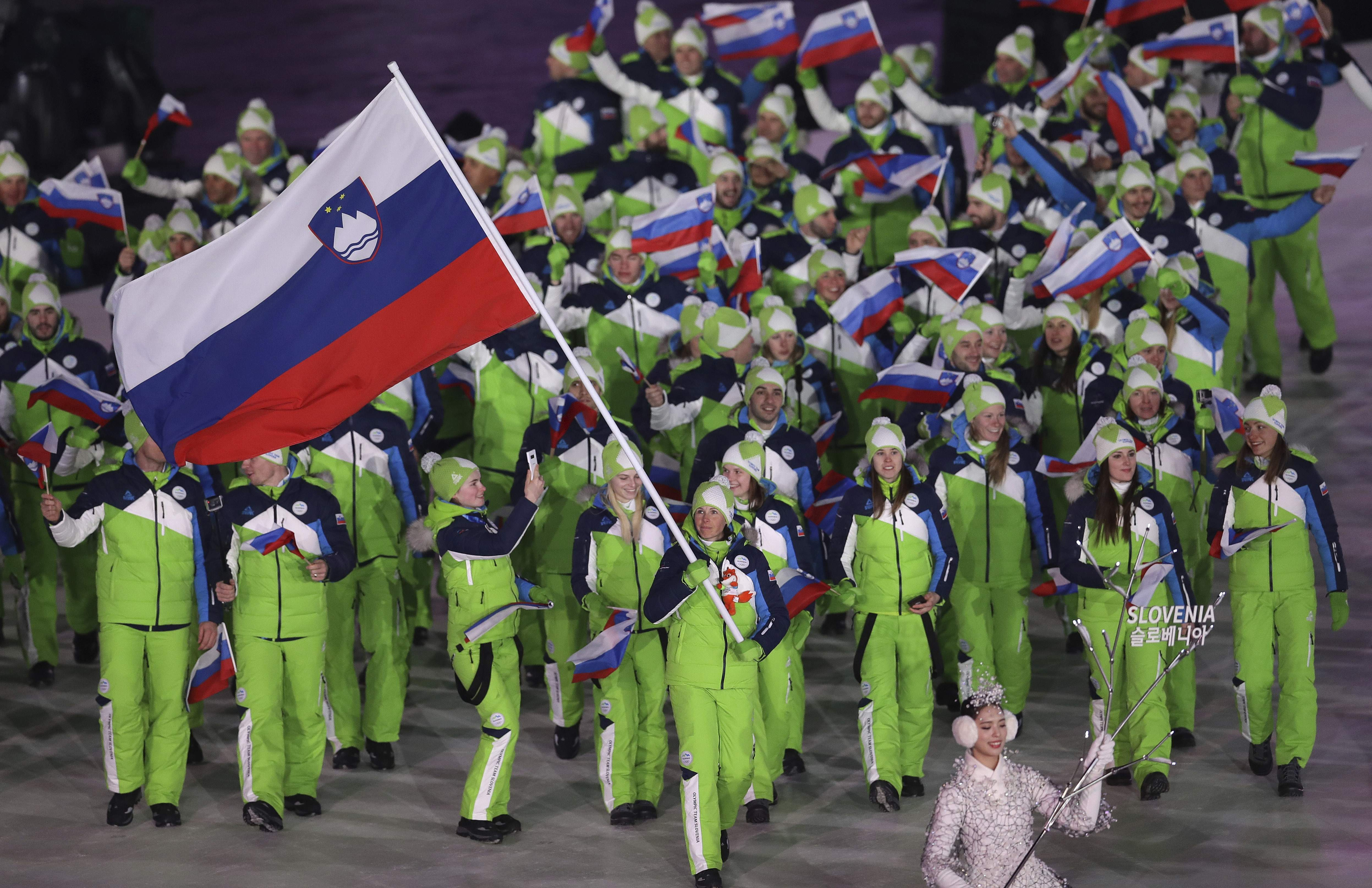 Vesna Fabjan carries the flag of Slovenia during the opening ceremony of the 2018 Winter Olympics in Pyeongchang, South Korea, Friday, Feb. 9, 2018. (AP Photo/Michael Sohn)