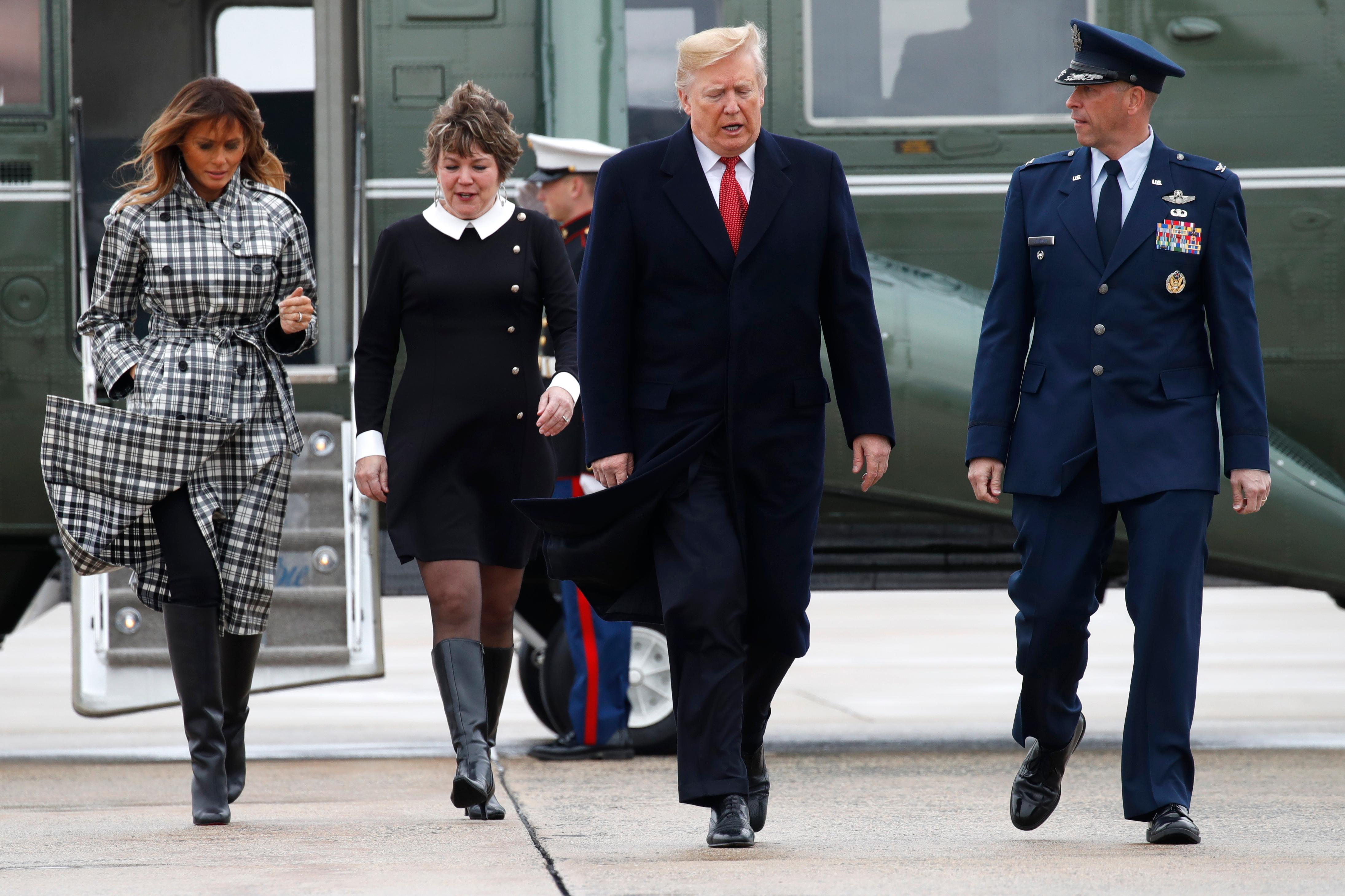 President Donald Trump and first lady Melania Trump walk to board Air Force One at Andrews Air Force Base, Md., en route to Paris, Friday Nov. 9, 2018, where they will participate in World War I commemorations. (AP Photo/Jacquelyn Martin)
