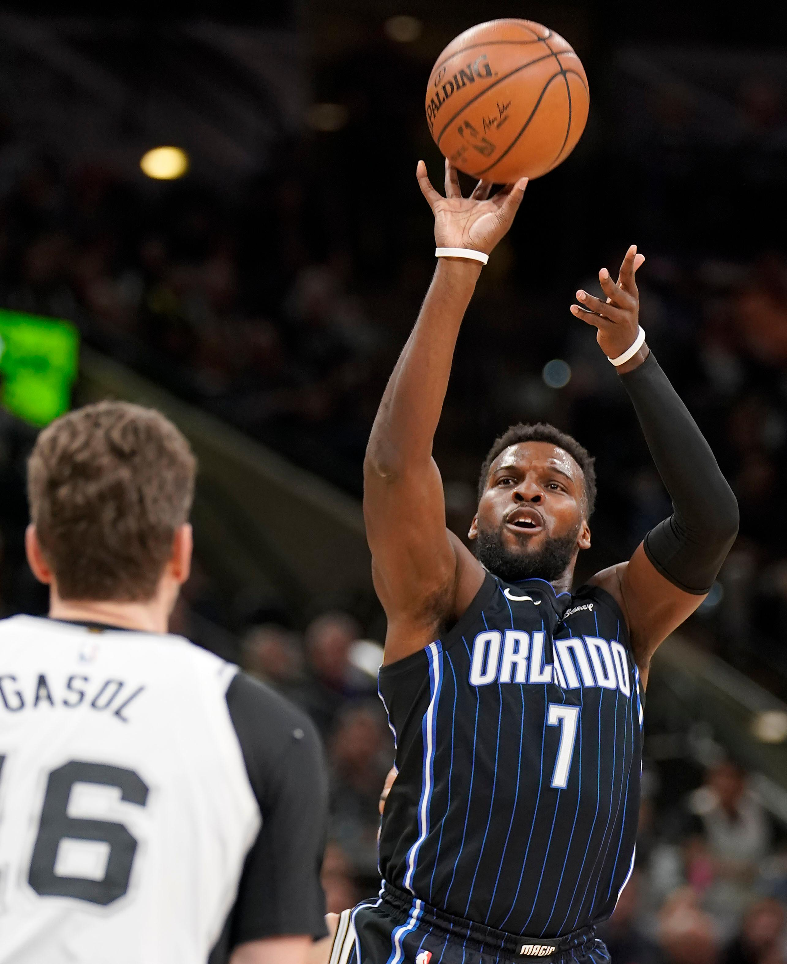 Orlando Magic's Shelvin Mack (7) shoots against San Antonio Spurs' Pau Gasol during the first half of an NBA basketball game, Tuesday, March 13, 2018, in San Antonio. (AP Photo/Darren Abate)