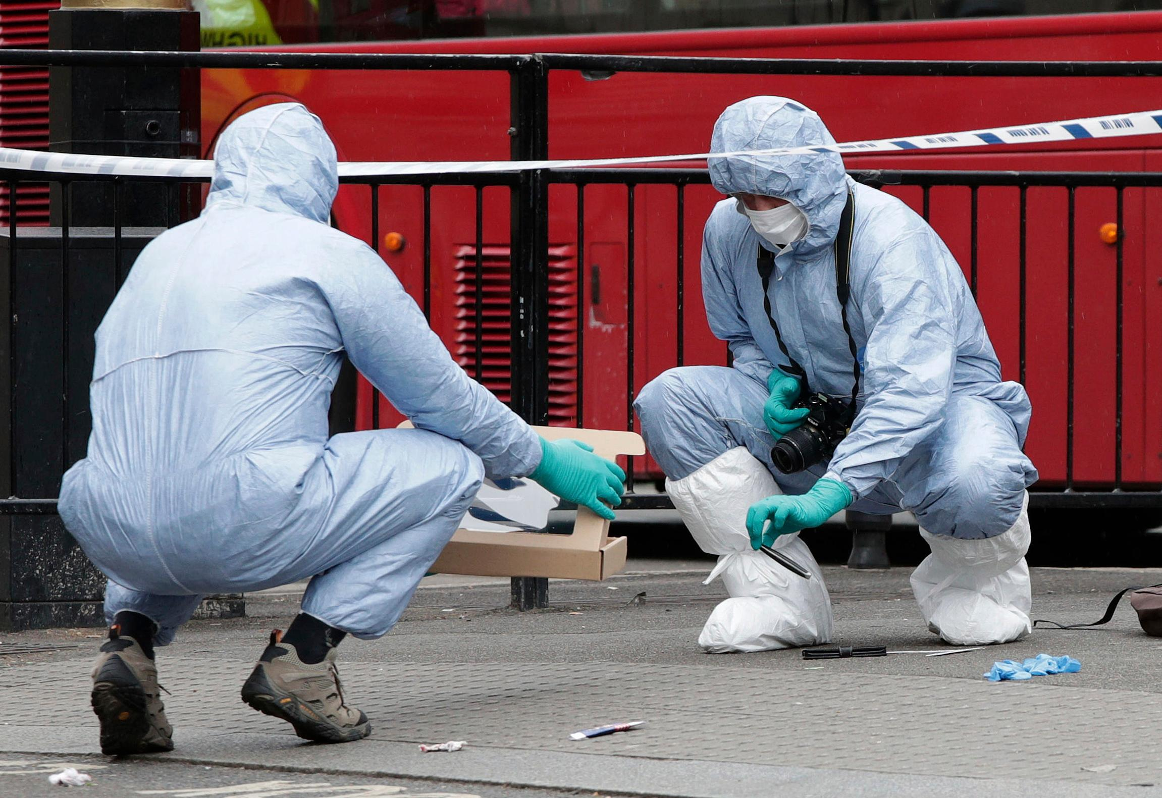 Police forensic officers attend the scene after a person was arrested following an incident in Whitehall in London, Thursday April 27, 2017. London police arrested a man for possession of weapons Thursday near Britain's Houses of Parliament. (Yui Mok/PA via AP)
