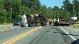 Man uninjured after overturning truck on Mobile Highway