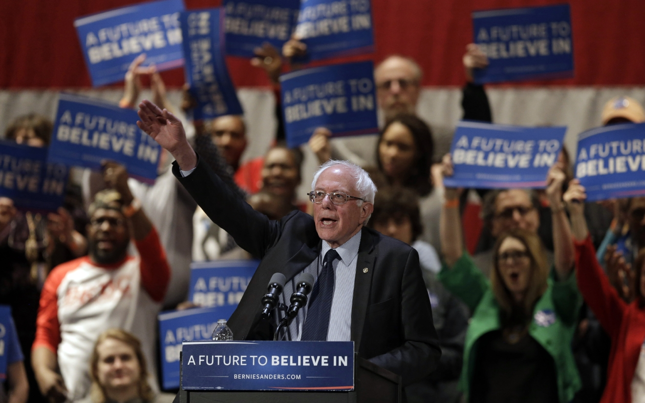 Democratic presidential candidate, Sen. Bernie Sanders, I-Vt., waves after speaking at a campaign rally at the Akron Civic Theatre, Monday, March 14, 2016, in Akron, Ohio. (AP Photo/Tony Dejak)