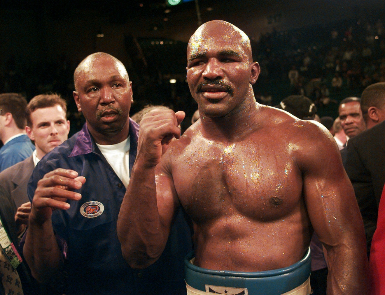 FILE -- In this Nov. 9, 1996, file photo, Evander Holyfield raises his fist after defeating Mike Tyson in their WBA heavyweight championship bout at the MGM Grand Garden in Las Vegas.  Former heavyweight champion Evander Holyfield and three-division champion Marco Antonio Barrera of Mexico head a list of nine people selected for induction into the International Boxing Hall of Fame, Tuesday, Dec. 6, 2016. (AP Photo/ Mark J. Terrill, File)